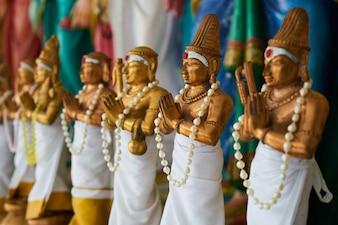 Statues of man praying