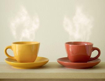 Steaming coffee cup on table