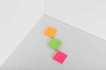 Sticky notes in different colors in corner of room