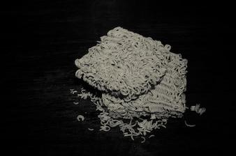 Still life instant noodles on black background