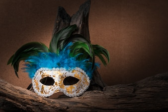 Still life painting photography with carnival mask and timber