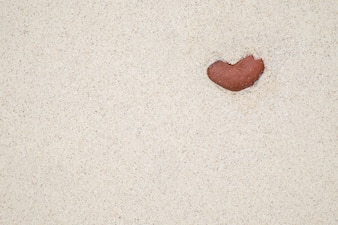 Stone hearts in sand.(selective focus)