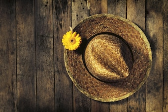 Straw hat with a yellow flower