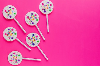 Straws with badges on pink