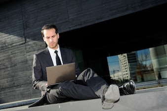 Stressed businessman working outside the office