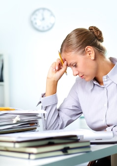 Stressed employee in her office