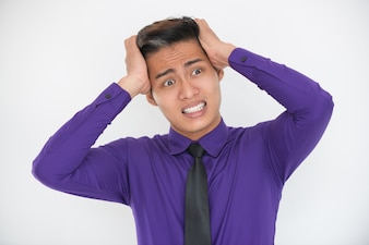 Stressed Young Business Man Clutching Head