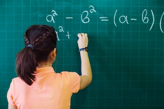 Student calculating on the blackboard