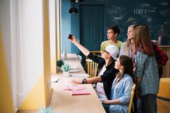 Students taking selfie in class