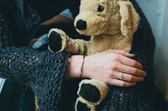 Stuffed animal in the hands