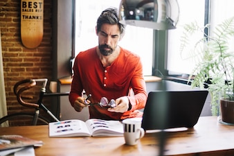 Stylish adult man working at desktop