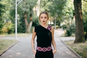 Stylish businesswoman walking an posing