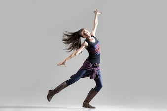 Stylish dancing young woman portrait