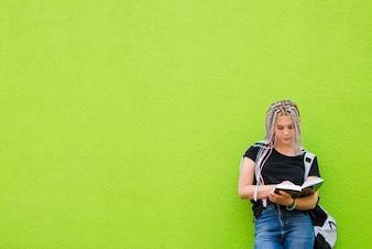 Stylish girl reading book