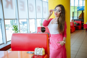 Stylish young woman posing in a restaurant
