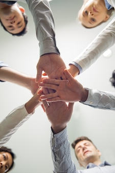 Successful business team stacking hands
