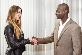Successful executive shaking hands with a client
