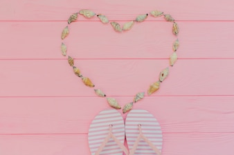 Summer composition with seashells forming a heart