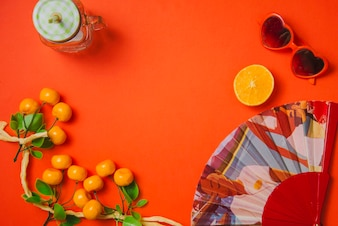 Summer decoration with oranges and spanish fan
