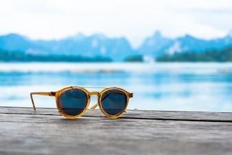 Sun glasses on wood
