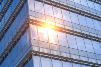 Sun reflected in windows of an office building
