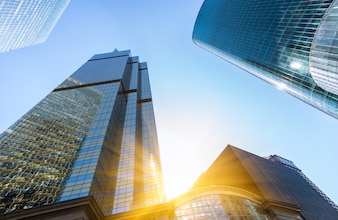 Sunlight shines through buildings and modern glass curtain walls