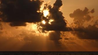 Sunrise light florida clouds back ocean skies sky