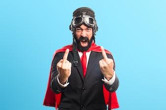 Super hero businessman making horn gesture on colorful background
