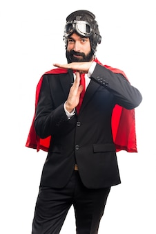 Super hero businessman making time out gesture