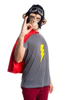 Superhero monkey man making OK sign