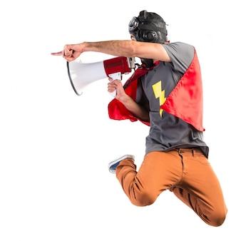 Superhero shouting by megaphone