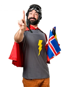 Superhero with a lot of flags touching on transparent screen