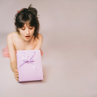 Suprised girl with present