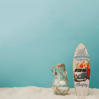 Surfboard and bottle on blue background