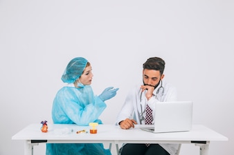 Surgeon and doctor discussing in the office