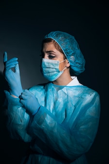 Surgeon posing in the darkness