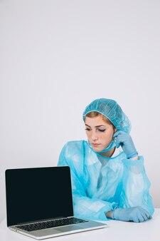 Surgeon posing with laptop's screen
