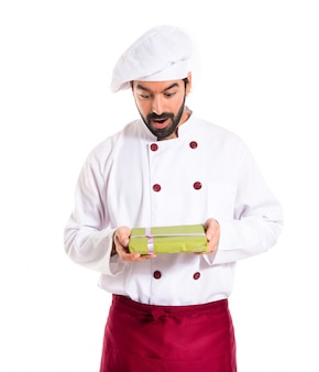 Surprised chef holding a present