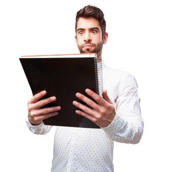 Surprised guy looking his notebook