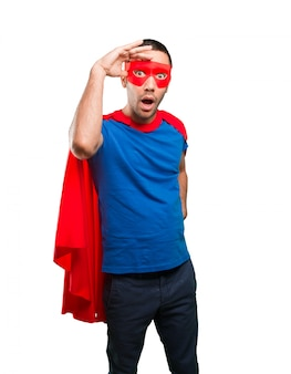 Surprised superhero with a search gesture