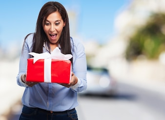 Surprised woman looking at a gift