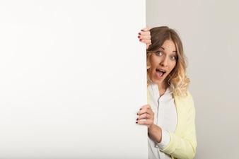 Surprised woman looking past the door