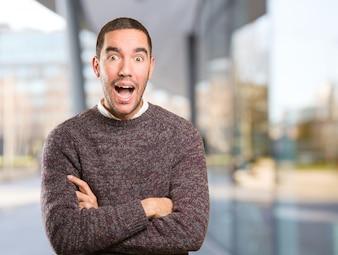 Surprised young man posing