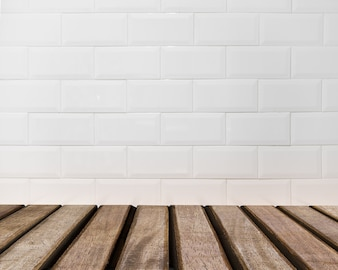 Table surface looking out to white brick wall