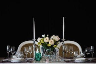 Table with plates and glasses and flowers