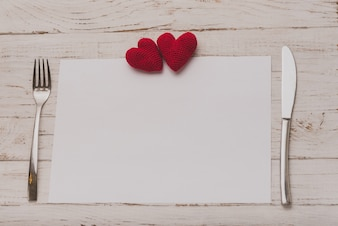 Tablecloth with cutlery and two hearts