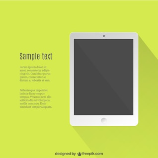 Tablet over green background