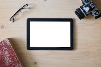 Tablet screen with camera eyeglasses and book