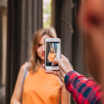 Taking photo of girlfriend with smartphone