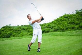 Tall man playing golf